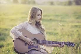 como tocar la guitarra