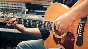 tocar guitarra electroacustica